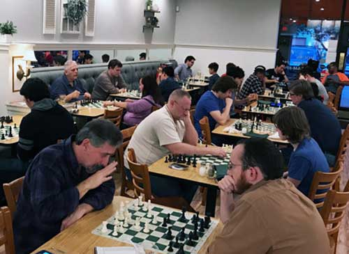 Players at our weekly chess club meeting.