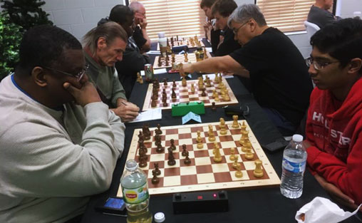 Players at an Arlington Chess Club Open monthly tournament